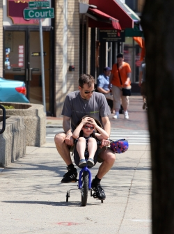 A dad takes over the pedaling and lets his son take a rest while biking down Massachusetts Avenue. April 16, 2012.