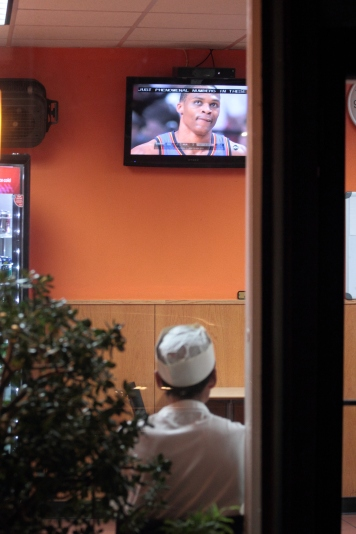 A chef at Tiki In on Massachusetts Avenue watches the NBA Finals during his dinner break. June 21, 2012.