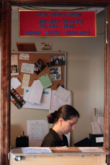 A woman tends to business in the Regent Theatre box office. June 16, 2012.