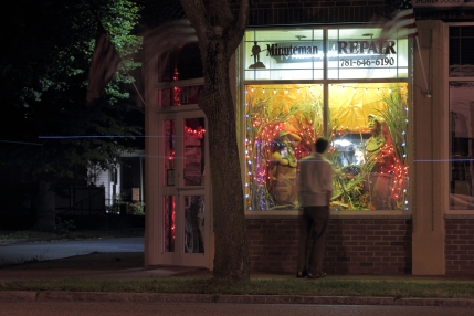 A man stops to look at the new fall display in the window of Minuteman Repair on Massachusetts Avenue. September 14, 2012.