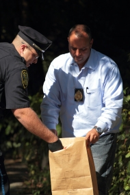 Arlington Police bag evidence found on Paul Revere Road after a bank robbery at Citizens Bank on Massachusetts Avenue. September 27, 2012.