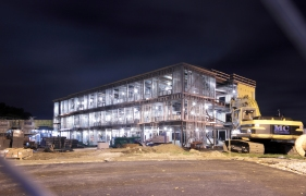 The skeleton of the new Thompson School is lit brightly so that work can continue after dark. October 15, 2012.