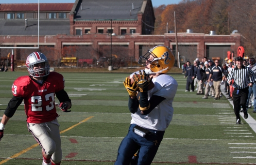 Arlington Catholic's Kyle Barios catches a pass for a touchdown in the third quarter of the Thanksgiving Day game against Arlington High School. November 22, 2012.