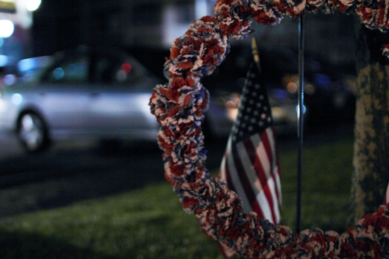 A wreath and flag at the Arlington War Memorial. December 7th is National Pearl Harbor Remembrance Day.December 6, 2012.