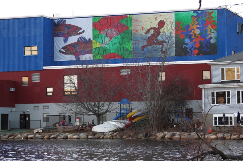 A large mural on the Spy Pond side of the Boys and Girls Club featuring the works of Jordawn Moses, Jobada Kachi, Lydia Genard, and Claire Stevens-Luneau, all Arlignton High School students.December 14, 2012.