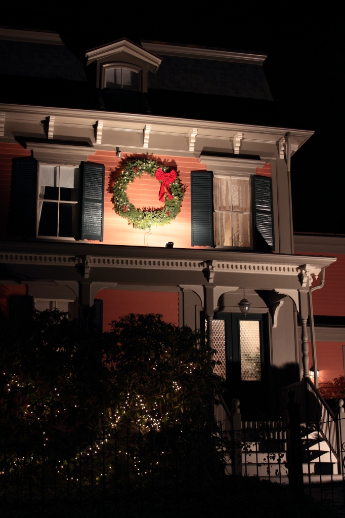 A wreath on an Academy Street home illuminated for the holiday season.December 23, 2012.