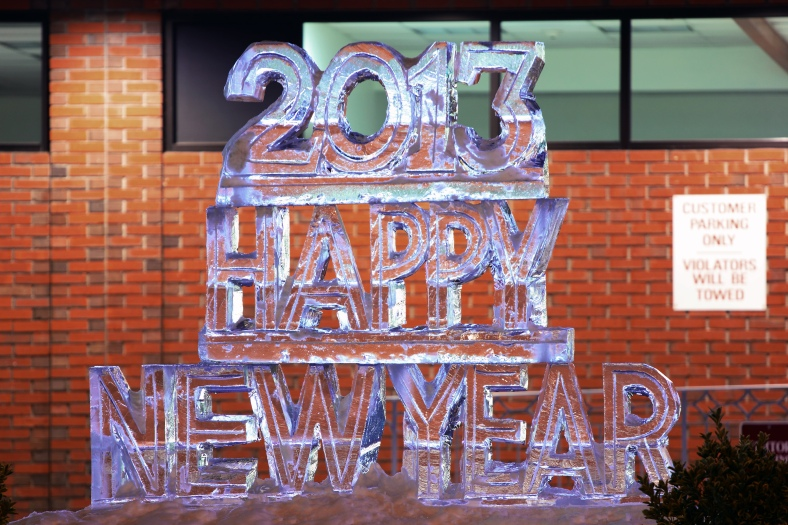 An ice sculpture in the parking lot of Leader Plaza on Massachusetts Avenue wishes everyone a happy new year.December 31, 2012.