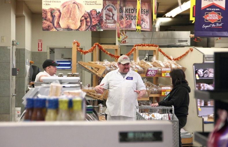 A shopper talks with Johnnie's Foodmaster employees during the final week and a half of the supermarket's existence.November 9, 2012.