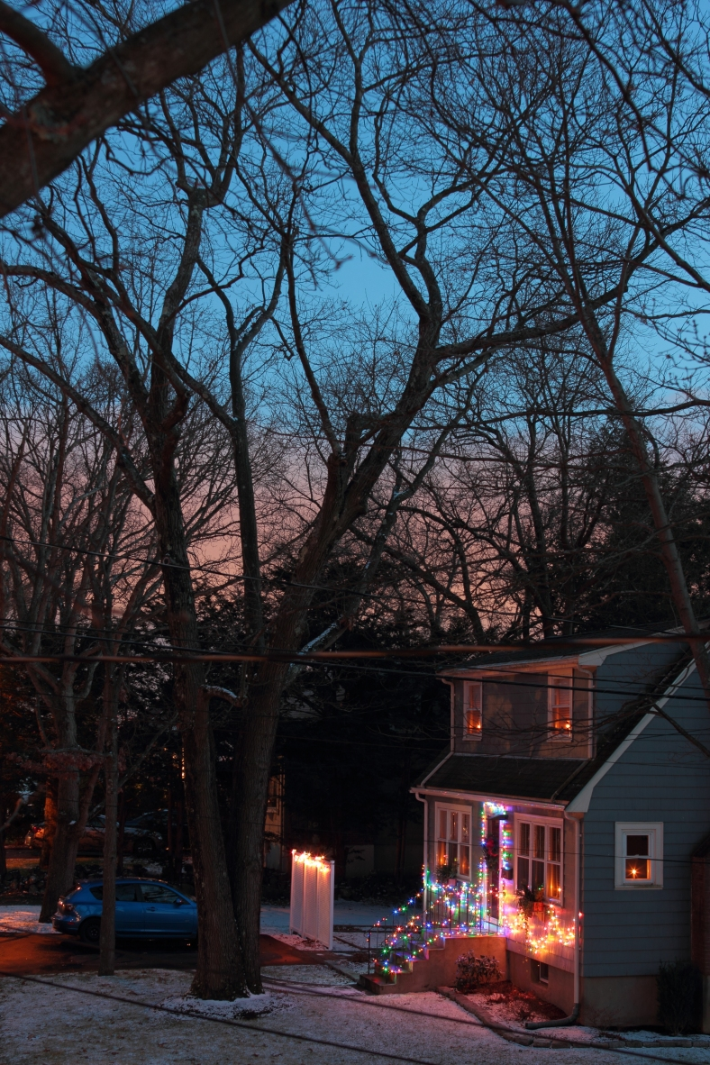 The setting sun illuminates low clouds on the horizon as the sun sets on Christmas day.December 25, 2012.