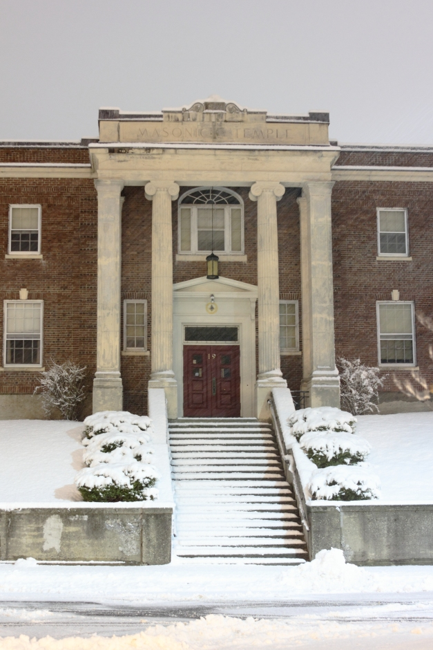 Snow collects quickly on the Masonic Temple on Academy Street.December 29, 2012.