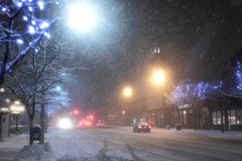 Cars carefully make their way down Arlington's main thoroughfare, Massachusetts Avenue, during a late December storm.December 29, 2012.