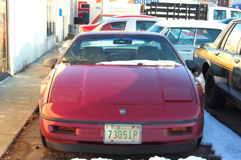 "A Pontiac Fiero, driven by Adam Sandler's character in the movie ""That's My Boy,"" sits in the lot of Anderson Automotive showing off a fresh coat of paint, covering the Rush starman logo that adorned the hood in the movie."