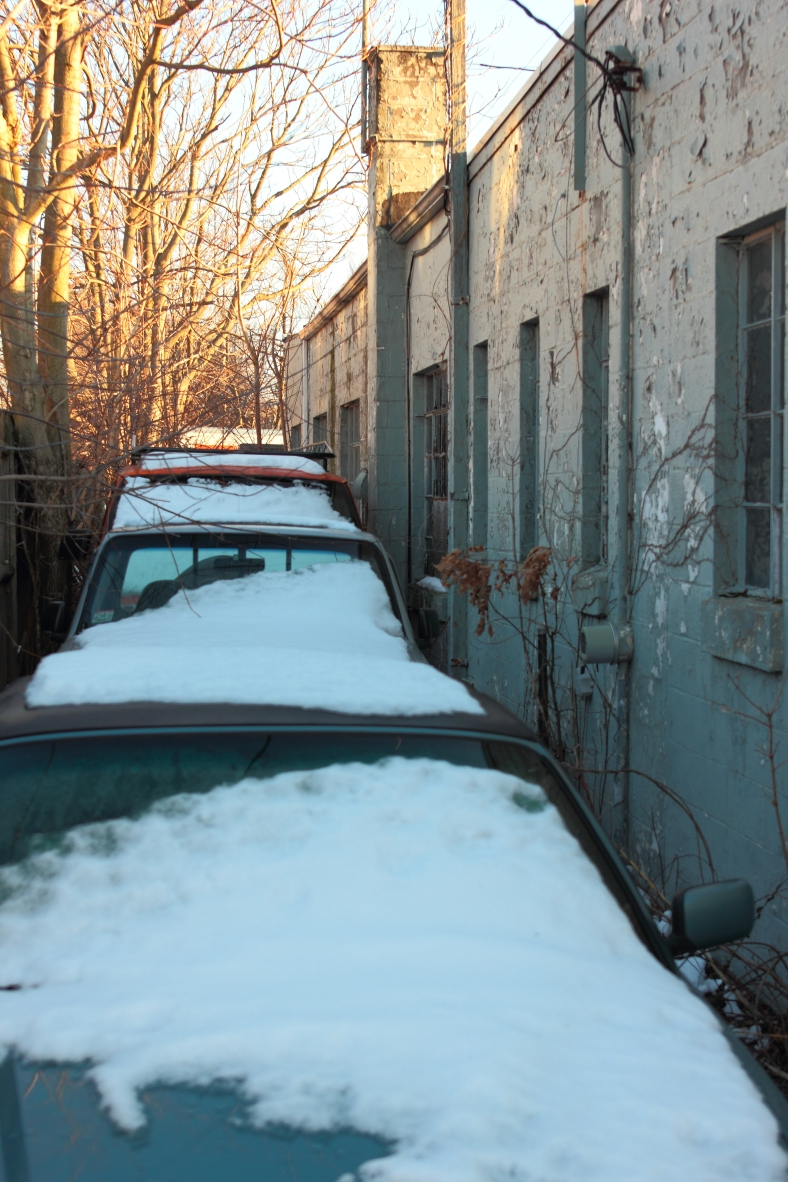 Snow covered vehicles lined up in the driveway behind Anderson Automotive.January 6, 2013.