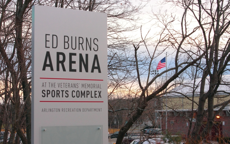A new sign bears the name of Arlington's skating rink, Ed Burns Arena, after Arlington High Hockey coach Ed Burns who lead the varsity team for 50 years.January 14, 2013.