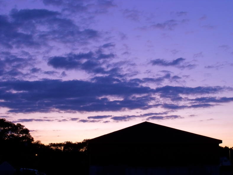 A Department of Public Works shed silhouetted against the twilight sky.June 29, 2010.