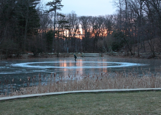 A skater creates a circle on the ice at Hills Pond in Menotomy Rocks park while he practices skating backward.February 2, 2012.