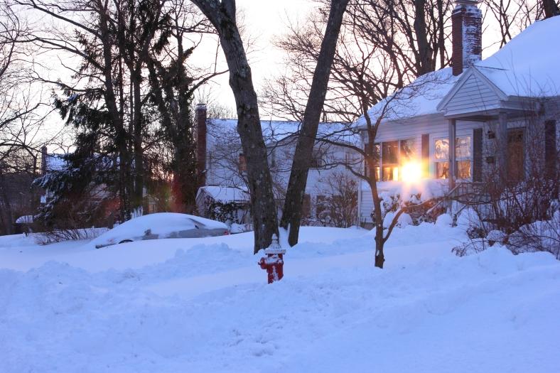 The setting sun shines through the windows of a Fabyan Street home.February 15, 2013.