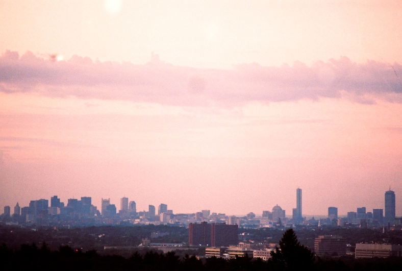 A view of Boston from Robbins Farm as the sun comes up.August 1, 2011.