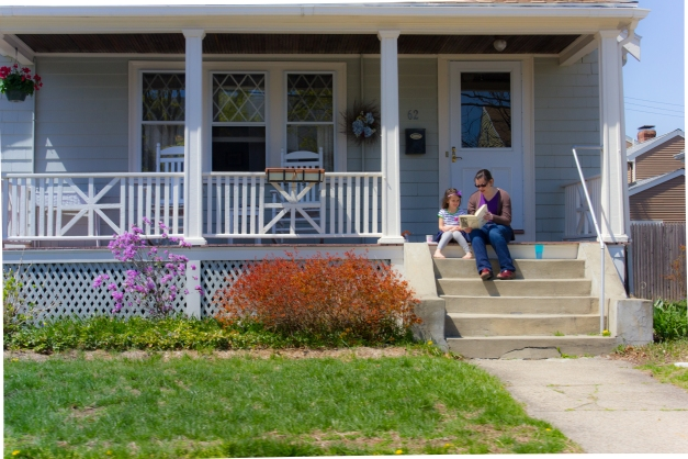 A woman reads to her daughter on the front porch of their East Arlington home enjoying the beautiful weather of spring. April 26, 2013.