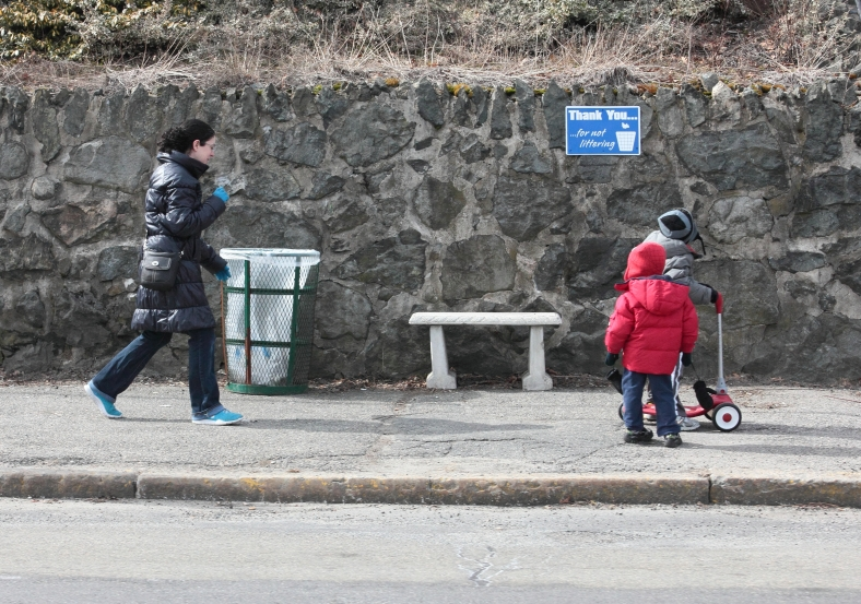 A mom keeps close behind her kids as they walk (and scoot) down Massachusetts Avenue. March 16, 2013.