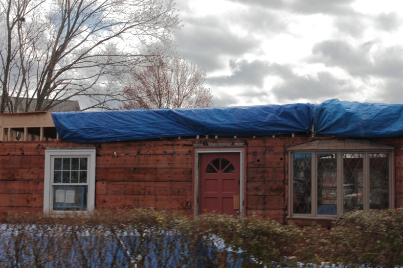 An existing house on Summer Street prepared for the construction of a  second story. April 13, 2013.