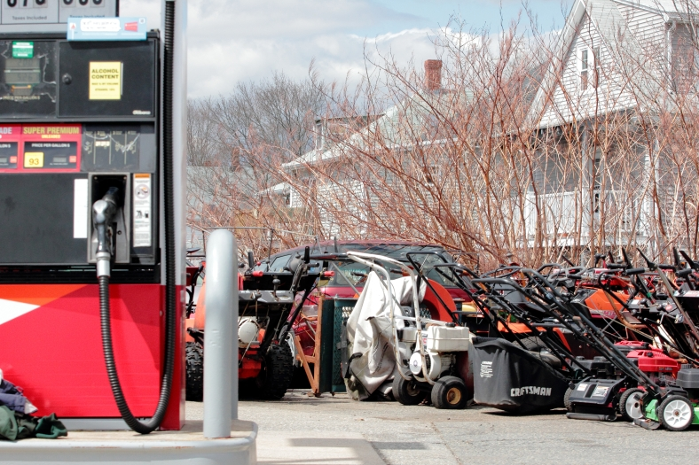 Lawn mowers and snow blowers in the lot of the Park Ave Citgo. April 14, 2013.