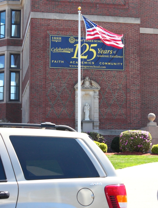 A banner hangs on St. Agnes School in celebrations of 125 years. April 26, 2013.