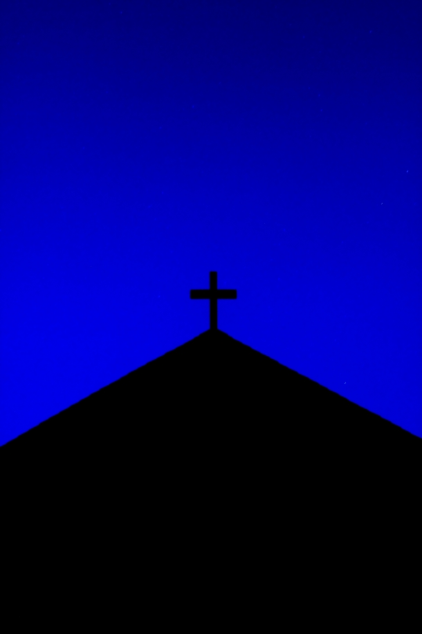 The Trinity Baptist Church in East Arlington silhouetted against the night sky. June 21, 2012.