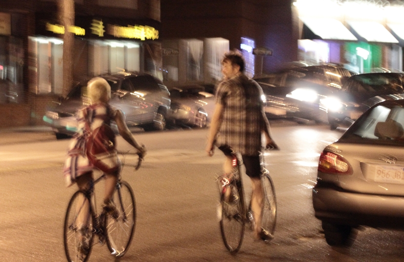 Two bikers chat as they ride down Massachusetts Avenue. June 21, 2012.