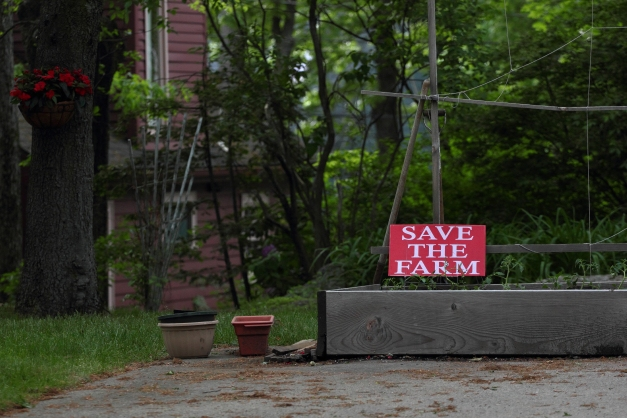 A sign on an Epping Street property urging us all to save the farm. May 28, 2013.