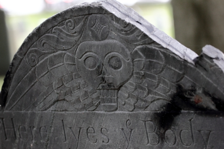 An old headstone, slightly worse for wear, in the Old Burying Ground. July 31, 2012.