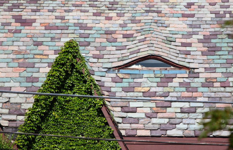 A small window in the roof of a Gray Street home. August 10, 2012.