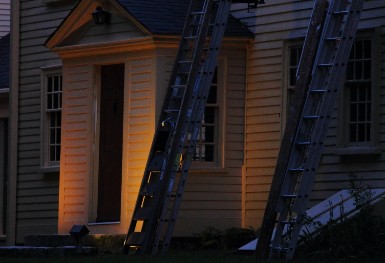 Ladders lean against the Jason Russell house overnight so work can continue first thing in the morning. August 24, 2012.
