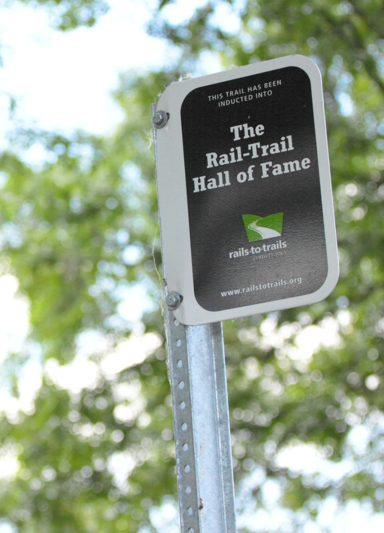 A sign along the Minuteman Bikeway near Thorndike field marking it's status as a hall of fame trail. May 31, 2012.