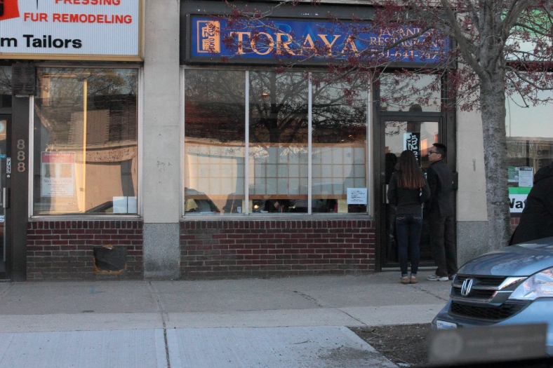 A couple waits outside the popular, but small, Japanese restaurant on Massachusetts Avenue. April 21, 2013.