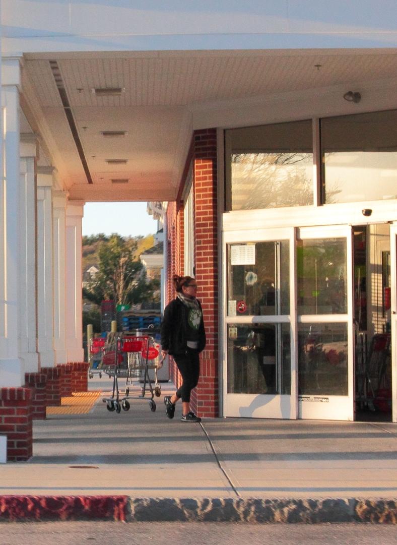A woman walks into the CVS next to Arlington High School. April 21, 2013.