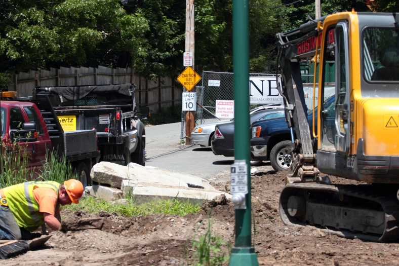 A lone construction worker at the Arlington 360 site along Summer Street. May 31, 2013.