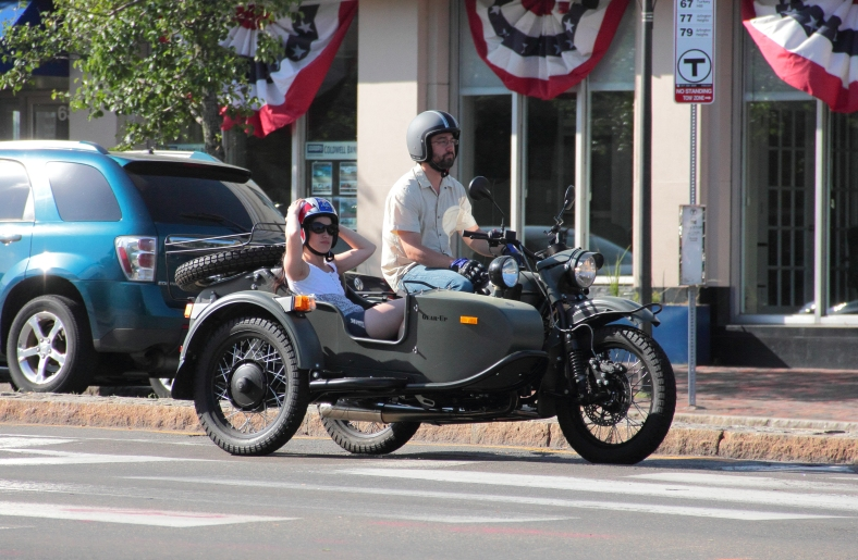 A motorcyclist and a sidecar-ist wait for the left hand turn in Arlington center. June 2, 2013.