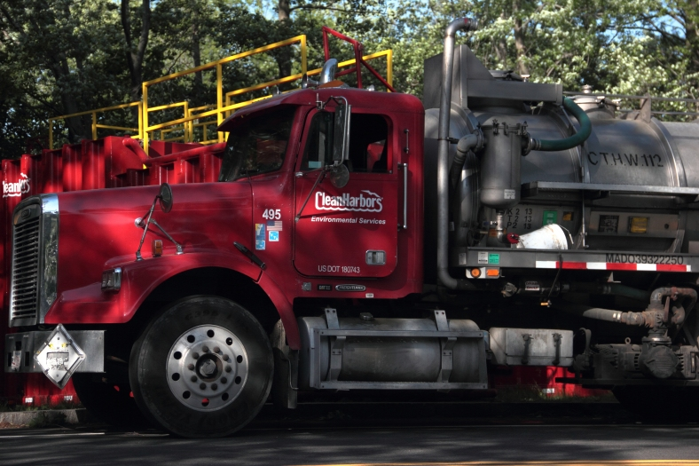 An environmental cleanup crew truck parked along Mystic Valley Parkway after a traffic accident involving a tanker truck sent thousands of gallons of gasoline into the Mystic River. June 2, 2013.