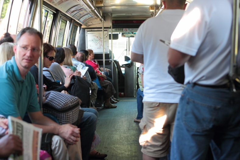 Arliongtonians fill the seats of the route 67 bus as it makes its way into town from Alewife Station. June 21, 2013.