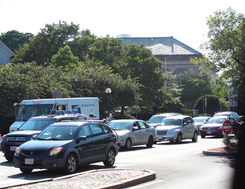Traffic in Arlington Center on a sunny first day of summer. June 21, 2013.