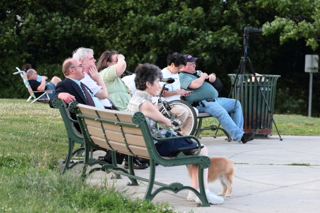 People wait on the benches at Skyline Park for the supermoon to rise. June 23, 2013.
