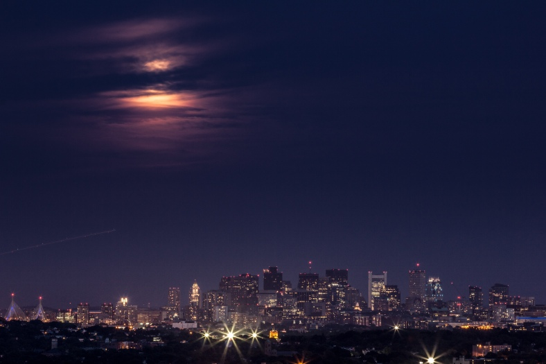 Sunday's supermoon behind the clouds over Boston as seen from Skyline Park. June 23, 2013.