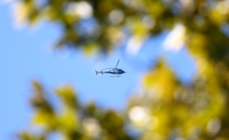 A news helicopter circles over Arlington Heights while covering a bank robbery at Citizens Bank on Massachusetts Avenue. September 27, 2012.