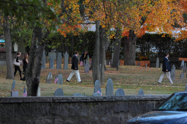 A family walks through the Old Burying Ground on their way to, or from, a special function. October 20, 2012.