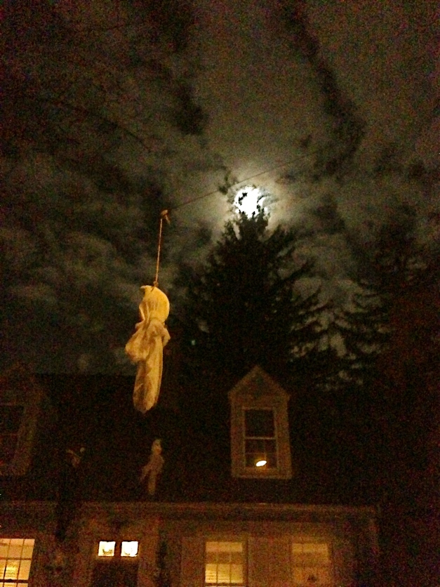Ghosts hang outside an Upland Road home in preparation for Halloween haunting. October 24, 2012.