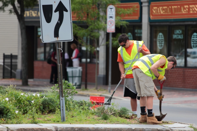 A crew works to tidy up a center island on Massachusetts Avenue. May 28, 2012.