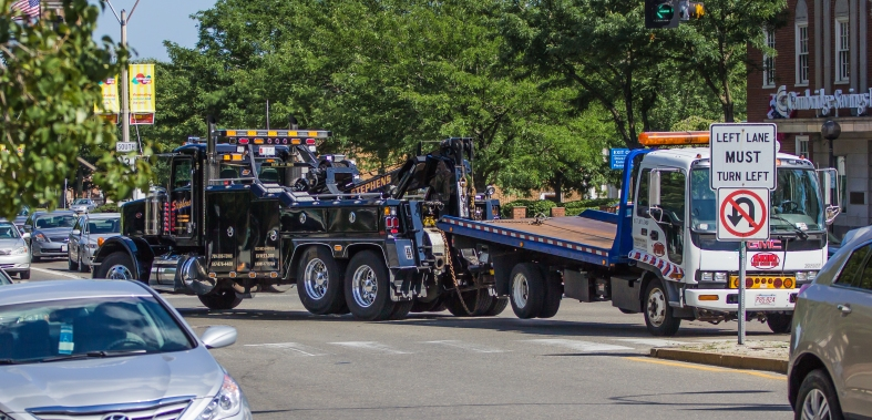 A tow truck tows a tow truck through Arlington Center. July 5, 2013.