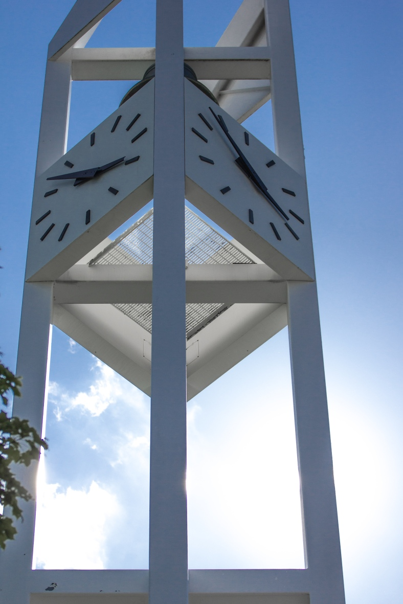 The clock tower of the First Parish Unitarian Universalist Church in Arlington Center blocking the sun on a hot summer day. July 5, 2013.