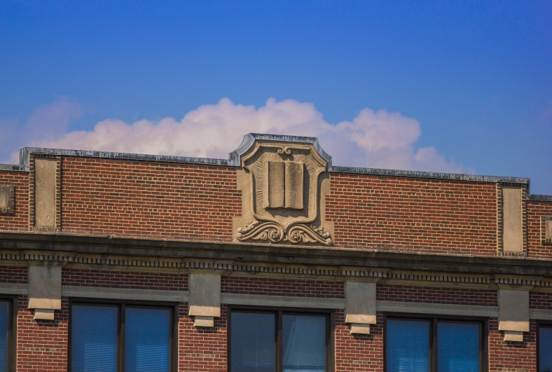 The shield atop the original building of Arlington High School. July 29, 2013.